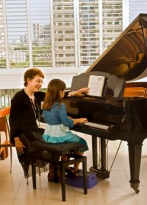 Piano Teacher with Child